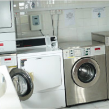 Our camping site has a large laundry room with washing machines and dryers